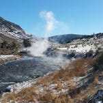 Steam rises near the center of the Gardner River at Yellowstone National Park's Boiling River in Montana.