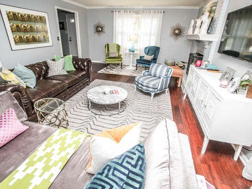 The Living Room Features A Lounge Area With A Restoration