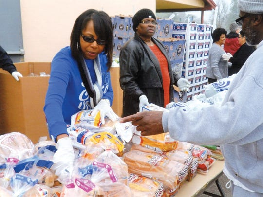 Cynthia Nesmith, the women's minister leader, volunteers during a food distribution at St. John Missionary Baptist Church in Tulare in 2015.