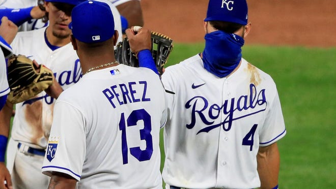 Kansas City Royals Salvador Perez (13) and Alex Gordon (4) celebrate following a 13-2 victory over the Chicago Cubs on Thursday night at Kauffman Stadium in Kansas City, Mo.