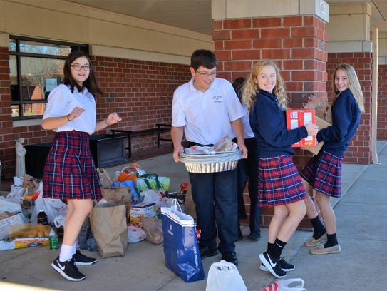 Our Lady of Victory Students, from left, Katie Howard,