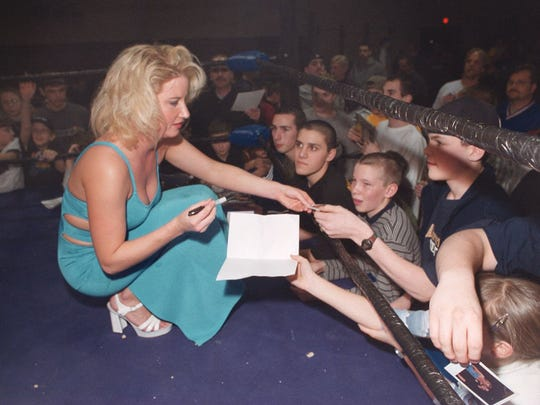 "Tammy ""Sunny"" Sytch of the WWE sign autographs for crowd at Brackmen School in Barnegat in this 2000 file photo."