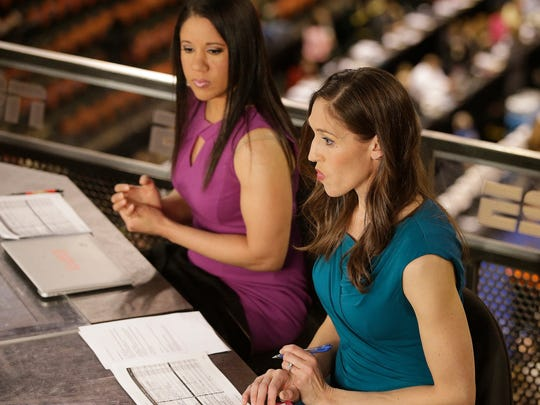 """In this Sunday, April 3, 2016 photo, Kara Lawson, left, and Rebecca Lobo prepare for a ESPN show before a national semifinal game at the women's Final Four in the NCAA college basketball tournament in Indianapolis. The witty banter that viewers see on-air is even more prevalent when the cameras stop rolling. """"Some of the best stuff happens when we're off camera,"""" Lobo said. """"Kara would say something and we're like you got to use that on air."""" (AP Photo/Darron Cummings)"""