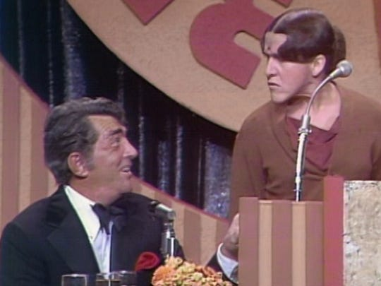 Ruth Buzzi and Dean Martin during a Jimmy Stewart roast in 1968.