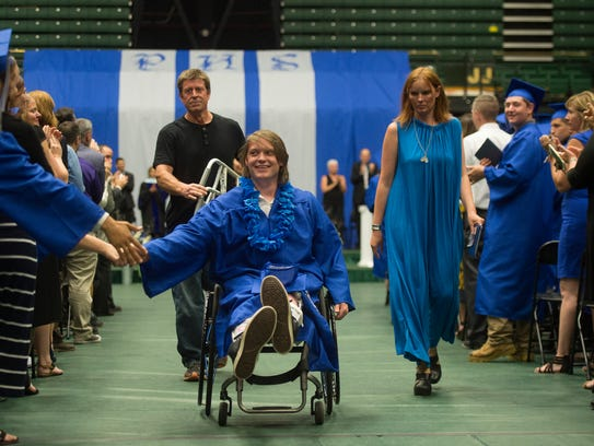 Poudre High School graduate Connor Walsh receives a