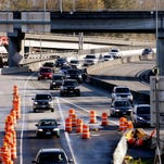 Traffic moves through a construction area on State Route 520 after crossing Lake Washington into Seattle on Nov. 19, 2015.