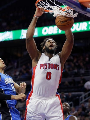 Pistons center Andre Drummond, right, dunks on Magic forward Tobias Harris, left, during the first half Monday at the Palace.