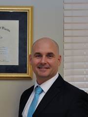Mike Mummert, attorney with Faga Law Group in Naples.