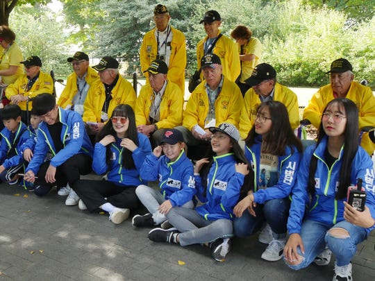 Korean children pose with Korean War veterans during an Honor Flight of Southern New Mexico trip to Washington, D.C.