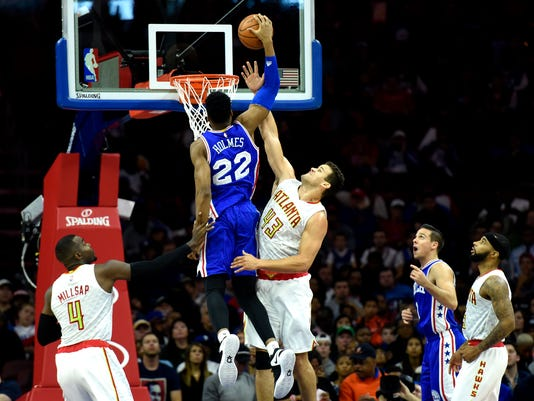 Philadelphia 76ers' Richaun Holmes (22) dunks the ball over Atlanta Hawks' Kris Humphries (43) during the second half of an NBA basketball game, Saturday, Oct. 29, 2016, in Philadelphia. The Hawks won 104-72. (AP Photo/Michael Perez)