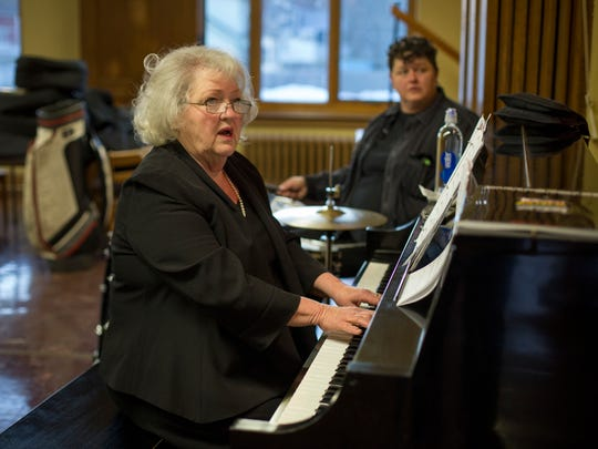 Director Carrie Stewart-Gulan sings and plays piano during rehearsal for Joseph and the Amazing Technicolor Dreamcoat Friday, Jan. 29, 2016 at First Presbyterian Church in Port Huron.