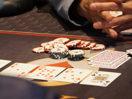 Players take part in a game of Texas Hold 'Em at PokerKing