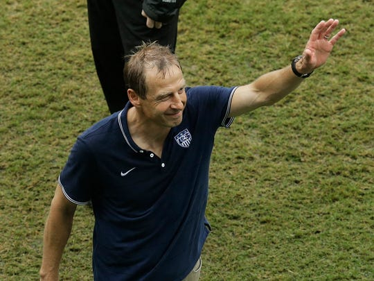 United States' head coach Juergen Klinsmann waves to fans after the United States lost to Germany 1-0 during the group G World Cup soccer match between the USA and Germany at the Arena Pernambuco in Recife, Brazil, June 26, 2014.