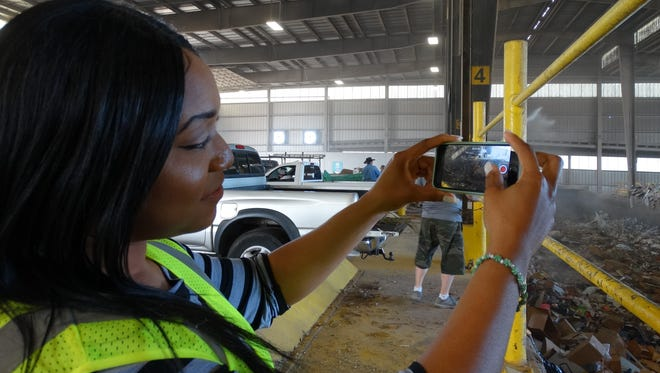 SCSWA Recycling Coordinator Tarkeysha Burton takes a short video on her smart phone to show residents what goes on inside the Transfer Station.