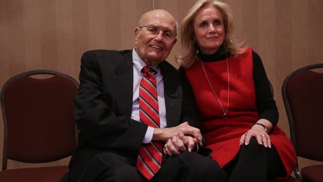 Rep.  John Dingell and his wife Debbie Dingell pose for a photo following a luncheon where Dingell addressed his retirement from being the longest serving member of congress at the Southern Wayne County Regional Chamber at Crystal Gardens in Southgate on Monday February 24, 2014. Ryan Garza / Detroit Free Press [Via MerlinFTP Drop]