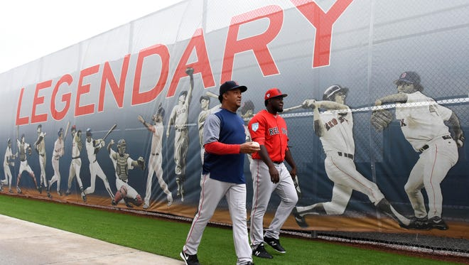 Red Sox special instructor Pedro Martinez, left, walks with pitcher Domingo Tapia during spring training at JetBlue Park in 2019.