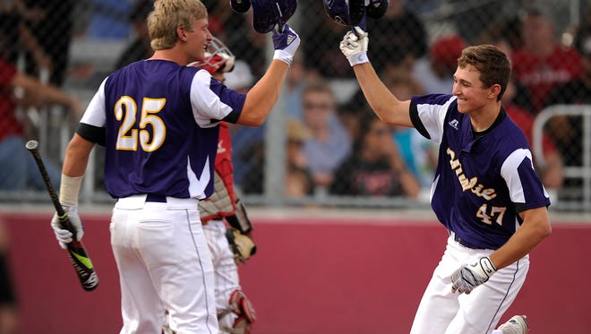 Wylie's Mason Schubert (47) is congratulated by teammate Caleb Munton (25) after a home run in the top of the sixth inning of the Bulldogs' 3-1 win in the Region I-4A semifinal playoff on Thursday, May 25, 2017, at Cardinal Field in Hermleigh.