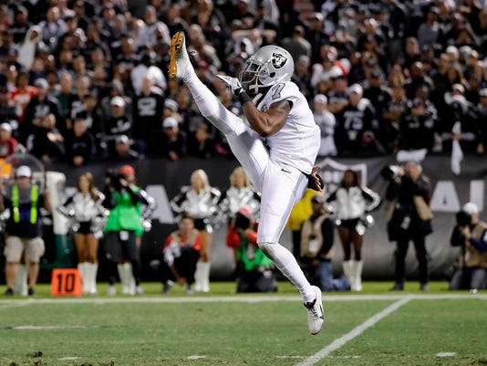 FILE - In this Oct. 19, 2017, file photo, Oakland Raiders' Marquette King punts against the Kansas City Chiefs during the second half of an NFL football game in Oakland, Calif. King has signed a three-year, $7 million contract with the Denver Broncos less than a week after his surprising release from the Raiders. (AP Photo/Marcio Jose Sanchez, File)
