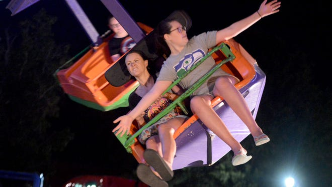 Shanna and Dylen Evans ride one of the rides Wednesday at the West Tennessee State Fair. The fair continues through Sunday, Sept. 18.