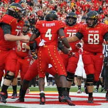 Maryland Terrapins running back Wes Brown (4) celebrates his rushing touchdown against the North Carolina State Wolfpack at Byrd Stadium in 2012.