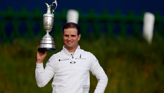 Zach Johnson holds the Claret Jug after winning the  the 144th Open Championship at St. Andrews - Old Course.