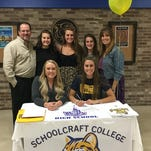 Pictured with Allie Lynn (seated at right) during her signing ceremony were (top row from left) father Don, sisteres Madison, Ashley and Natalie, mom Denise and (seated next to Allie) Schoolcraft coach Shannon Pummill.