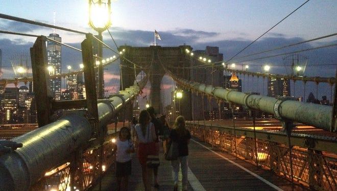 Pedestrians make their way from Brooklyn to Manhattan along a walkway on the Brooklyn Bridge on Aug. 27.