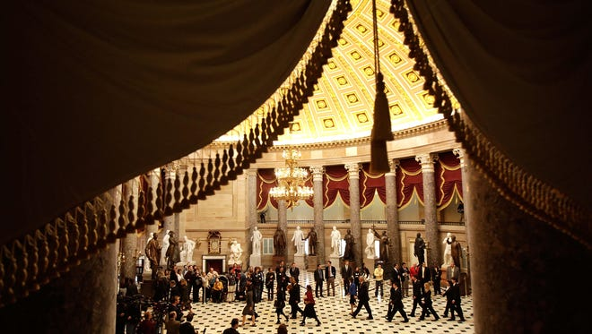 U.S. Senate members escort Electoral College ballots through Statuary Hall in 2009 on their way to the House Chamber in the U.S. Capitol.