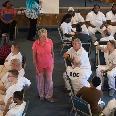 Kim Book speaks to inmates at the Sussex Correctional