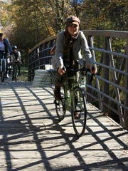 Riders make their way through Greenough Park during the Missoula Tweed Ride.