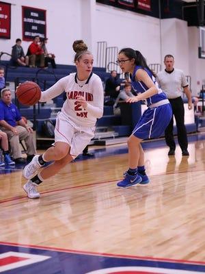 Carolina Day senior Tess Harris, left, has signed to play college basketball for Western Carolina University.