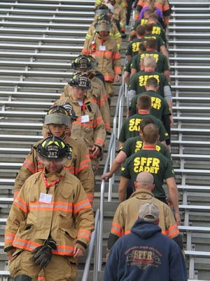 Participants in the first Step Up for Heroes event climb stairs at Howard Wood Field to honor those who lost their lives in the Sept. 11, 2001, terrorist attacks.