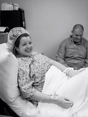 Ashley Shirley smiles in disbelief as she stares at her healthy baby girl.