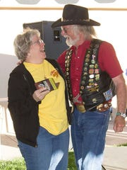 LouAnn Spath of Lindsay,Texas, seen here with rally organizer Ron Andrews, is the grand prize winner of a new Harley Davidson. She and her husband have been attending the rally for 30 years.