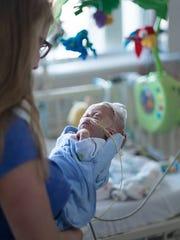 Katie Butler holds her son, Dewey, as a newborn.