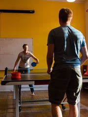 Loft 912 members and guest compete in a ping-pong tournament