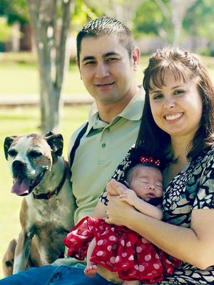Luke and Heather Jones, with their daughter and dog.