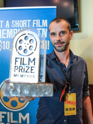 """Matteo Servente, director of """"We Go On,"""" winner of the second annual $10,000 Memphis Film Prize, poses with his award."""