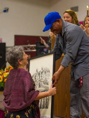 "Luis Lopez-Diaz, known in the community as Raul Gomez, gives First 5 Director Claudia Harrison  a print during the ""Night in Oaxaca"" event in 2014."
