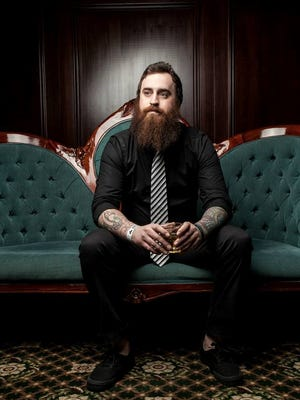 Josh Cooper is photographed at the Emerald Coast Beard & Mustache Alliance's one-year anniversary at the Pensacola Grande.