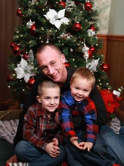 Colby Hewitt with his sons, Parker and Malachi.