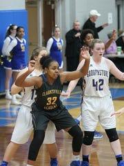 Clarksville Academy's Keisha Phillips (32) posts up