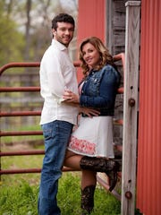 Sonny and Heather Melton pose for pictures at his grandparents' barn in Big Sandy, Tennessee.