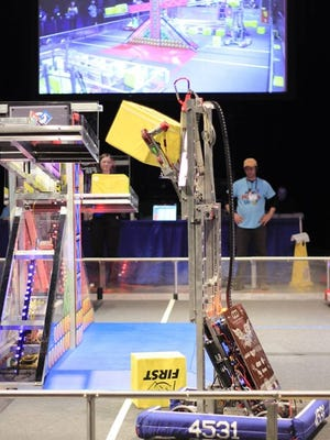 The Two Rivers High School STEMpunk robot performs in regional competition in Duluth, Minnesota.