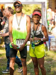 Morcelli Kombo (left) with his mother, Eddah Mutua. Mutua ran in her second Boston Marathon on April 16, 2018. Kombo will run in the Earth Day 5K on April 20, 2018.
