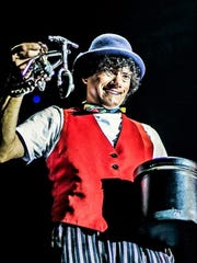 """Coco the clown shows off his bike at Cirque Italia's """"Water Circus."""""""