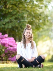 Reagan is happy to work with clients like Sierra Dodson to capture their unique personality.
