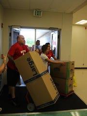 Delivering boxes of back packs