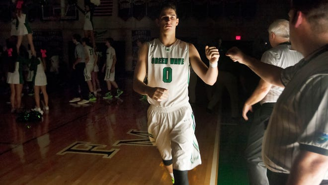 Fort Myers High School's Mark Matthews is introduced Friday against Bishop Verot at Fort Myers High School. Matthews needs nine points to become the fifth Lee County boys basketball player to score 2,000 career points.