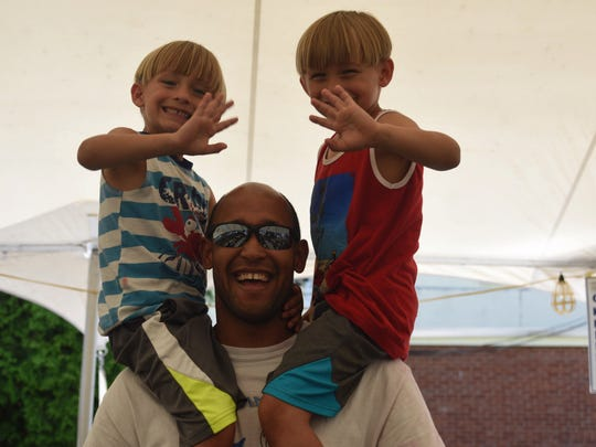 Thomas Franklin, 40, of Wappingers Falls, and 5-year-old twins, Kyle and Kurt visit the Greek Festival in Poughkeepsie Sunday.